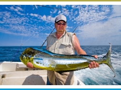 Sportfishing in Coco Beach: Fisherman has caught a Mahi Mahi or Dorado fish.